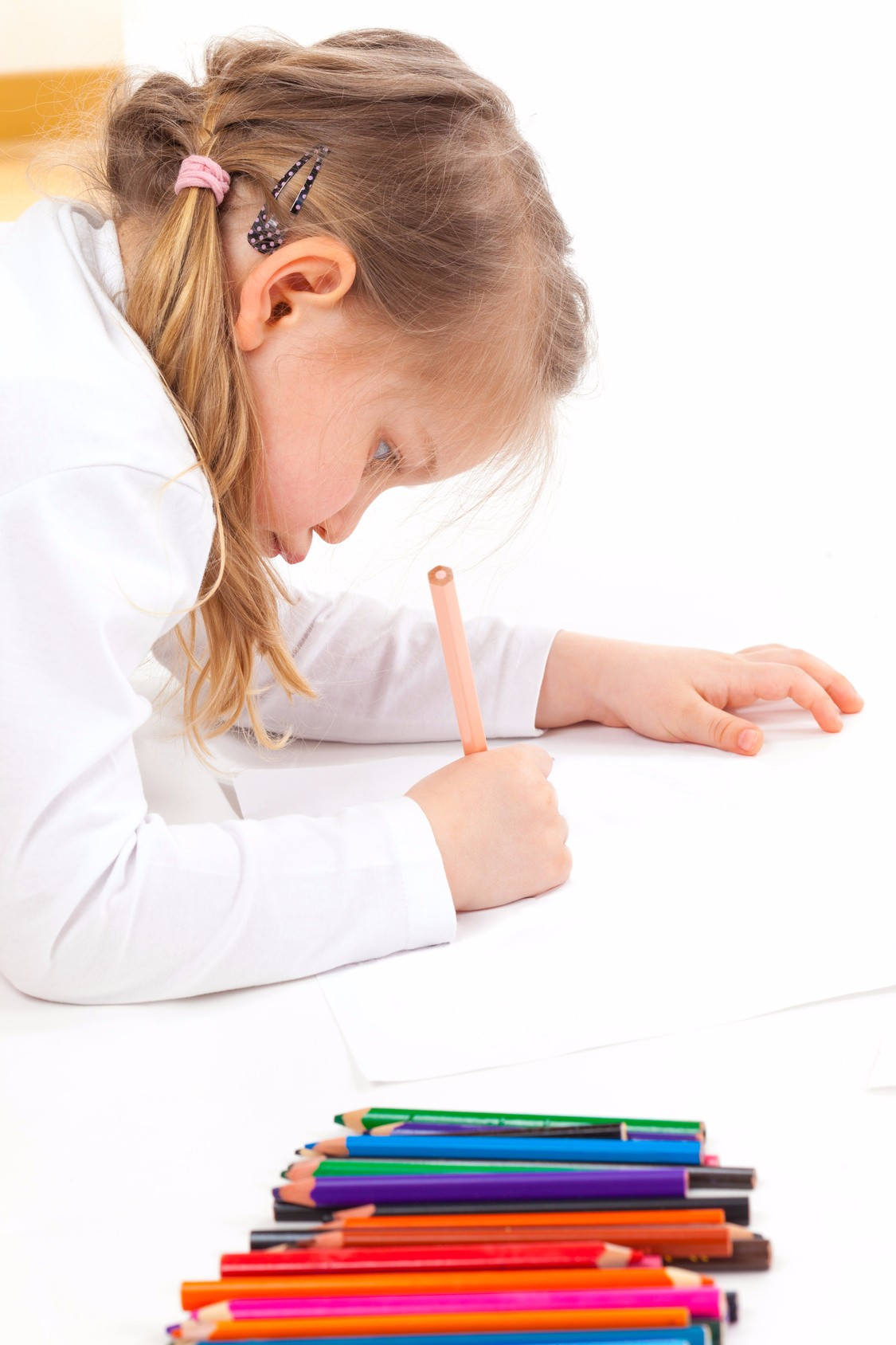 Girl starting to draw a picture with coloring pencils